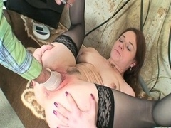 Excited doctor fist-fucking naughty nurse in sizzling hot sexy stockings