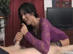 Elegant brunette tugs on this hard cock