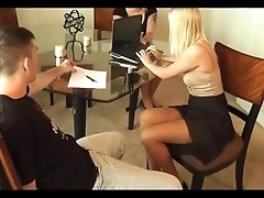 Blonde real estate agent gives footjob in front of his wife