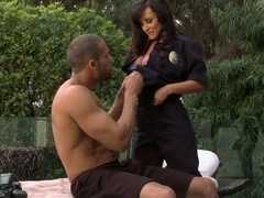 Buxom dame Lisa Ann in police uniform does oral job