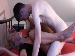 Young-looking guy fucks two hot milfs hard