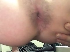Teen shows off tight hairy asshole and strokes cock